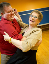 Milan retired executive, Kathleen Wheeler, 79, waltzes again with QC dance instructor Günter Schlueter, after her successful back surgery and total knee replacement.