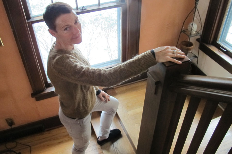 Susan Flansburg on stairs